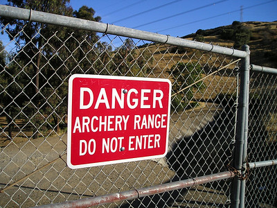The trailhead is sandwiched between a golf course and an archery range. We didn't need to be warned twice.