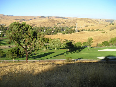 Half a mile along, we're already looking well down on the golf course; we're parked on the far side. Golf courses...compare and contrast to the unirrigated surrounding landscape. Water shortages? Pah!