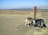 Whew! At the top of the steepest bit for today. San Jose stretches out beyond us. The dogs check the more-local messages.