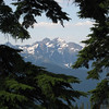 glimpse through trees to Three Fingers Mtn (with another FS fire lookout, also maintained by Everett Mountaineers)