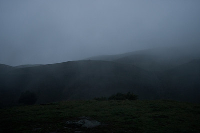 Foggy hillsides.