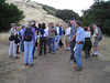 Large crowd of Sierra Club Singles Wednesday Nighters, waiting at an early trail junction.