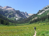 Entering Spider Meadows on the first day. The trail continues up the green cliff slope at left center up to Spider Gap.