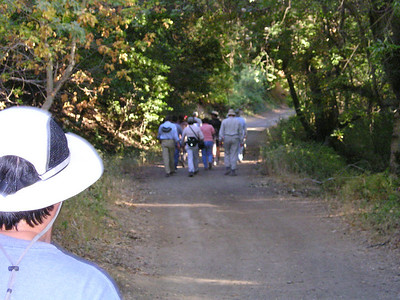 The group heads up the road and the photographer lags.