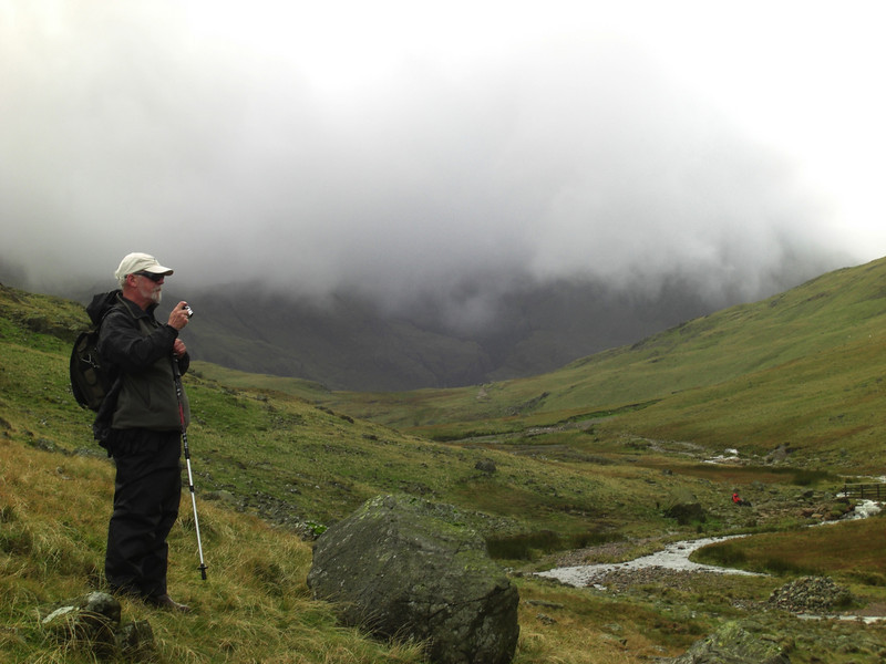 Simon with our destination beyond - still hidden in thick cloud