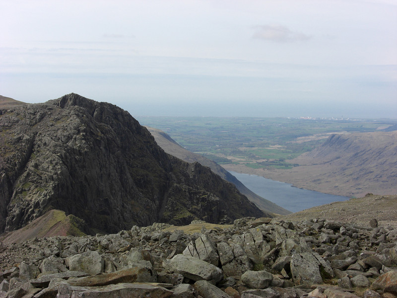 A glimpse of Wastwater, on reaching the summit of Scafell Pike from the Borrowdale side.  Mickledore and Scafell in the left foreground.