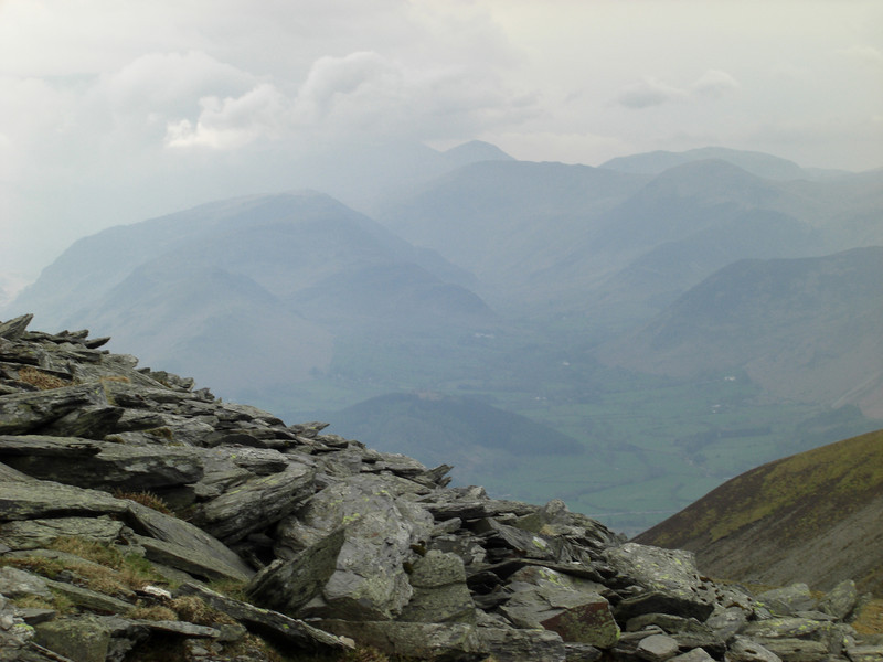 Borrowdale Fells in the distance, with Great Gable and the Scafell range disappearing into the clouds