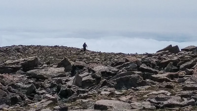 David atop the rocky Trouble Benchmark at 12,622 ft