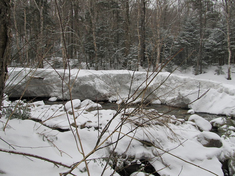 The Little River flows between walls of snow in many places thanks to big rain storms 2-3 weeks ago.  Making water crossings interesting.  ice bridges are gone in many places in the Whites.