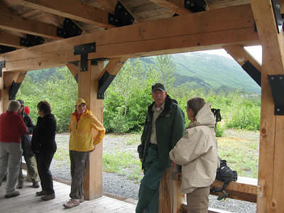 Waiting in the shelter with the ranger for the train to return.  Part of our group accompanied the ranger on the narrated hike to the lake viewpoint.  Left to right: Etta Mae Near, Barbara McNinch, Bobbie O'Neill, Dee Richards, the ranger, Jodie Linnell.