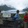 Spencer Glacier and lake complete with ice burgs.  Jodie Linnell reading the interpretive sign explaining how the Spencer Glacier has receeded.  Carol Boehmler in blue talking with Sherrie Henderson in red.