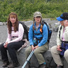 Cindy Finwall, Barbara McNinch and Linda Swarner sitting at a rest and view spot along the trail.  Note the gravel pad beautiful rock work.  The arms of the bench are made from railroad tracks.