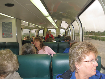 Enjoying the ride.  Etta Mae Near standing in the red.  Cindy Finwall in pink (not the greatest photo ... sorry Cindy), Julie Jones in the blue jacket seated next to Betty Harris.