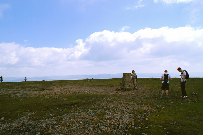 Ingleborough summit doesn't even look like a mountain.  I looked for my compass, lost in snow and mist here 18 years ago, but it was gone.
