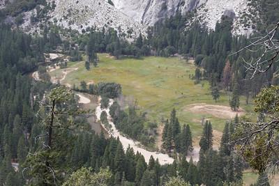 Below us, a tame Merced River flows through Yosemite Valley.