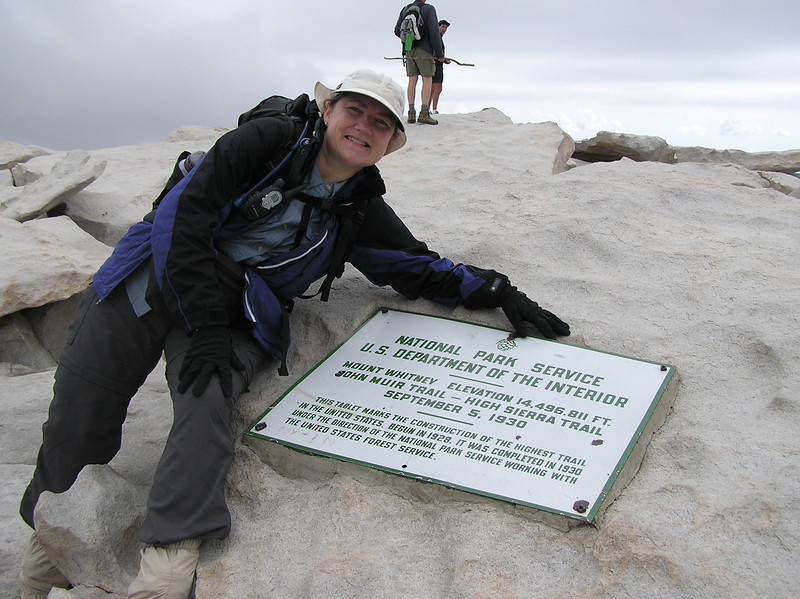 Kay at the top with the sign