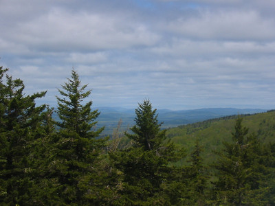 Sunapee in the back with Avery Ledge and Haystack forming something of a notch in front.