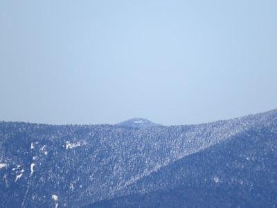 Hutchins peeking out over the ridge to Waumbek