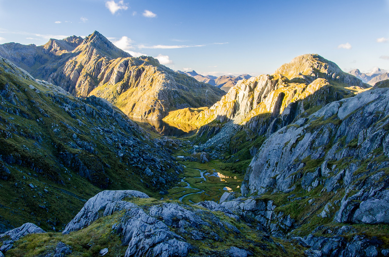 A look down the Valley of the Trolls to Lake Harris.  Morning light illuminates Ocean Peak, Harris Saddle, and Conical Hill