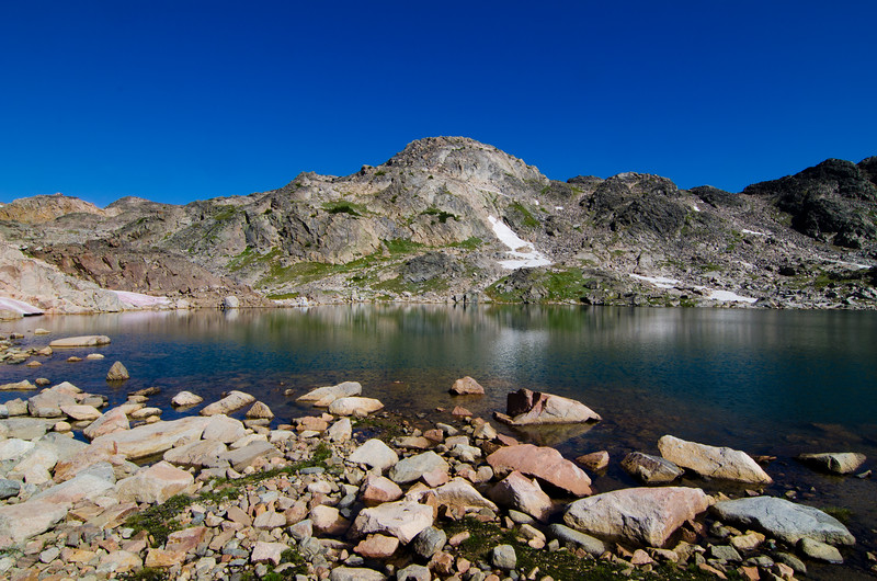 The next morning, I broke camp and aimed for Looking Glass Lake.  From there, I ascended a low saddle to the east and dropped into the drainage containing this unnamed lake.  I would follow this drainage down to Fossil Lake and the East Rosebud Trail.