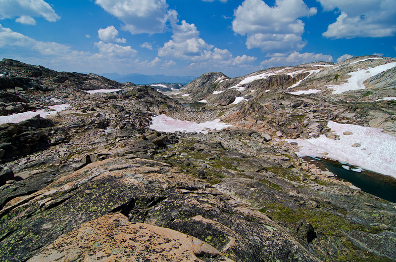 Nearing my high point on the divide.  This is pretty characteristic of the terrain in the high lakes area.  A mix of snow, rock, grass, and water makes for interesting, sometimes complex routefinding, but overall, the area is reasonably forgiving for cross country travel.