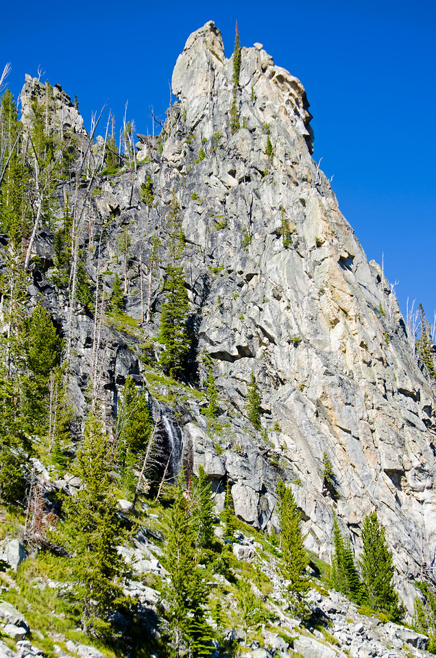 A spire above the Canyon Creek Valley and an inviting little waterfall
