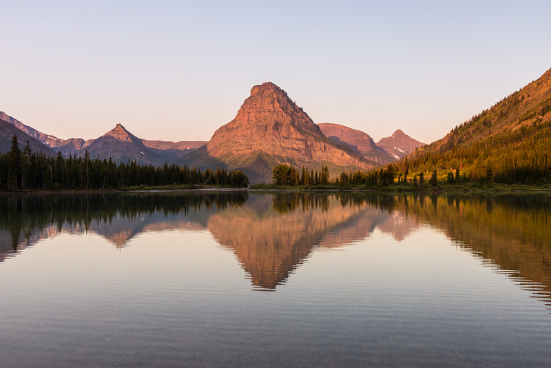 Some morning light on Sinopah and reflections in Two Medicine Lake