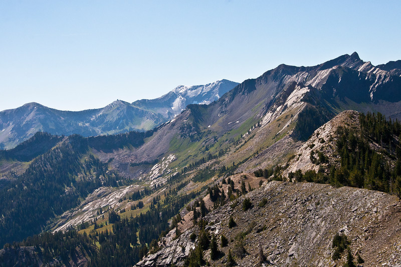 Mt. Superior, Cardiac Bowl mid frame. Mt. Baldy, Hidden Peak, and American Fork Twin Peaks left to right rear ground. Two different Twin Peaks visible from this summit.