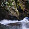 Immediately downstream from Barbara's, the creek runs all along a huge rock wall