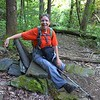 Brenda, sitting on a rock bench