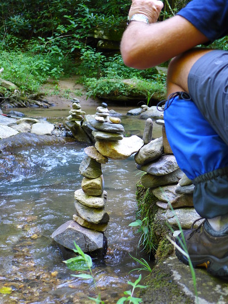 So, these next 12 photos are probably way more than needed, but between the intricacy of this multi-level, multi-secton rock cairn, and Mark's intent work on adding to it, I couldn't decide which photos to skip!!