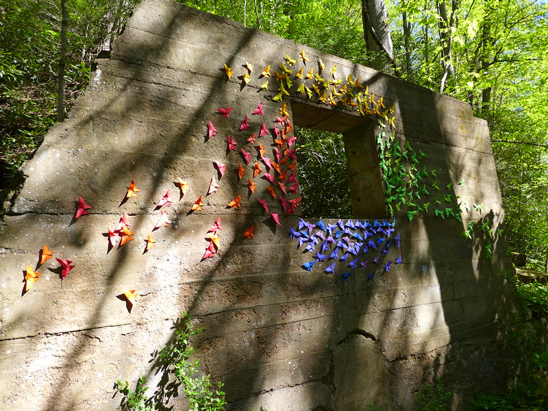 "This structure is right adjacent to the old dam, and was probably an adjacent building or something.   It now is just this old stone wall and ""window"".   Someone afixed these ""butterflies"" to the wall.    I'm not usually a fan of doing stuff like this, but I had to admit, this was really an attractive display."