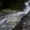 Mark, climbing upstream at Cleft Falls