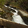 The most interesting part of this waterfall to me was this section right in the middle of the photo, where the creek runs down a curve, with a tall, vertical section on the outer edge (river left).   The creek then swishes around and up, making a rooster tail type of splash.<br /> <br /> I tried every which what to capture what I was actually seeing, without much success.