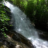 """<h1>Jones Gap Waterfall - Side View</h1>For comparison of how much more water volume there is from normal, <b><u><a href=""""http://www.flickr.com/photos/nc_hiker/9304299536/"""" target=""""_blank"""">look at this photo from my 2009 visit</a></u></b>."""
