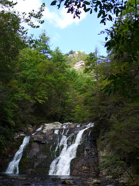 """<h1>Potato Top</h1>Right in the center of the photo you can see a rocky pinnacle jutting above the terrain.  This is a cylindrical piece of land that juts 400 feet above the falls.  Laurel Fork winds almost completely around this """"tower"""" of rock, with only about 800 feet of land between the two sides of the loop.  Very, very steep rocky terrain all around."""