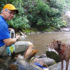 <h1>Lunch time at the falls</h1>(....and yes, depsite her poor, pitiful, <i>I-haven't-been-fed-in-a-week </i>  look, Kona also got some lunch!)