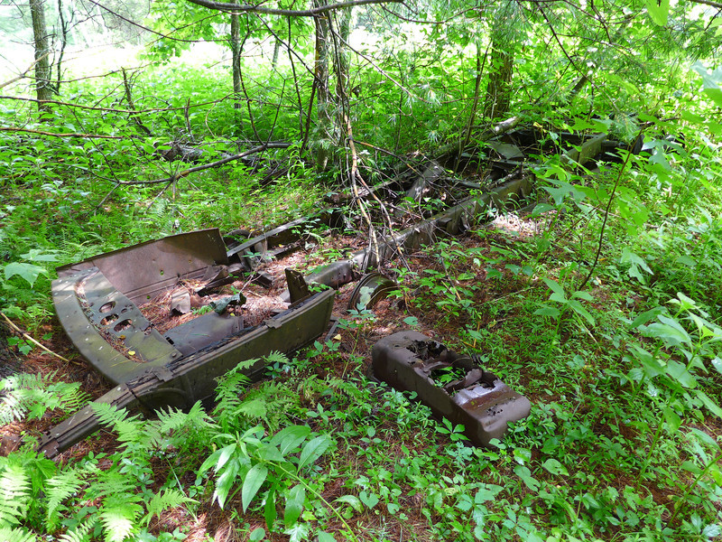 <h1>Flatbed</h1>I'm calling this a flatbed, as in part of a flatbed portion that would hook behind a truck.  I'm assuming that's what this is.  It was close to the old truck, but not immediately adjacent to it.