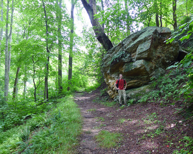 <h1>Van, along side a large rock outcropping</h1>He noticed that the second of two old chimneys we saw was made out of the same kind of rock as this boulder.