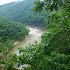 <h1>Nolichucky River</h1>This was taken from our lunch spot --- a narrow rocky knoll high above this river.  The area has received massive amounts of rain (13-14 inches in the month of July), and the river was really raging.    You can see 5 rafts on the little beach area ... these were from a local rafting company taking a couple dozen folks down the river.  This spot is apparently their lunch spot.