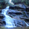 "<h1>Nellie's Falls</h1>...on Flat Creek in northern Panthertown.  I think these are one and the same with the waterfall on the Kornegay map that is called ""Hidden Falls"".  Rich Stevenson has <b><u><a href=""http://www.ncwaterfalls.com/nellies1.htm"" target=""_blank"">a nice write up</a></u></b> of how Bernie Boyer found these, and made a hiking trail to them."