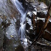 Water gushing down a rocky sluice