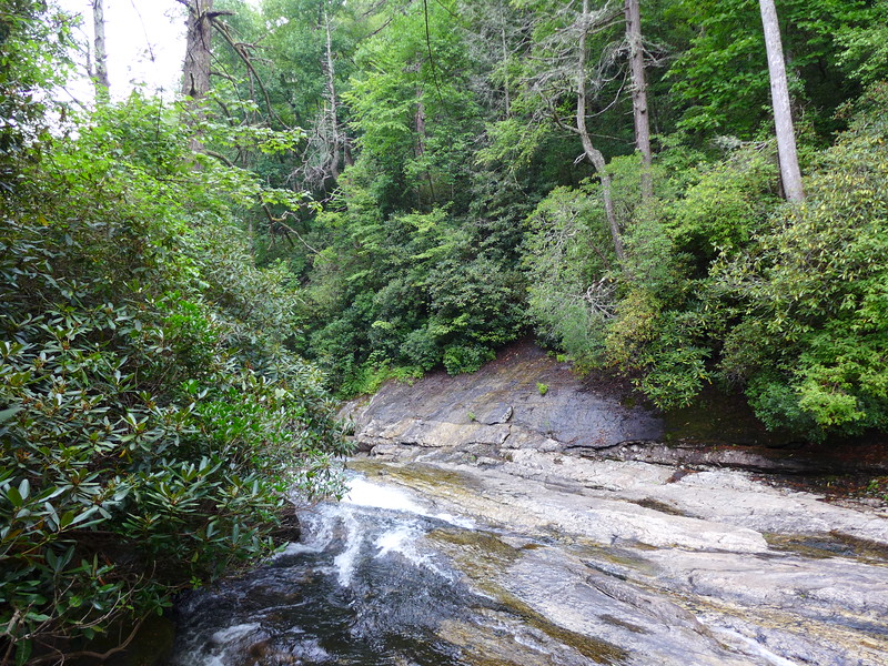"""It's hard to tell in this photo, but this is a section of the Horsepasture river, immediately downstream from where you come out to the river when you come via """"<u><a href=""""http://www.brendajwiley.com/side_pocket_falls.html"""" target=""""_blank"""">Bernie's Trail</a></u>"""".   The entire river bed, as well as both sides of the river are one rocky channel through which the river tumbles.  There is also a significant drop to this section .... ie, the rocky river bed slants downriver at a significant angle.  It'd be neat to see this section from the base, but you'd need to head down there from a lot farther up on the hillside."""