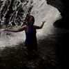 Tricia, behind the falls