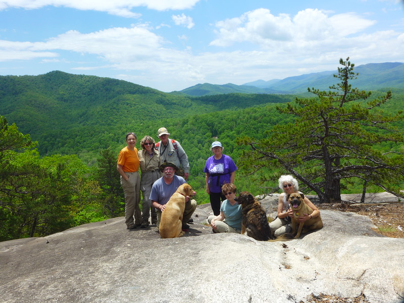Standing (l to r): Brenda, Pat, Gordie, and Judy.  Sitting (l to r): Jack (with doggie Sara), Mary (with doggie Bailey), and Pat (with doggie Murphy).   Not shown are Terry and Marilyn.  They were our two speediest hikers, and I think they were on the trail already!!