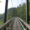 "<h1>Suspension Bridge</h1>...that spans Tallulah Gorge.   You are still WAAAAAY above the river at this point.  To see this bridge in perspective of the Gorge itself, <b><u><a href=""http://nc-hiker.smugmug.com/HikingTrips-6/Tallulah-Gorge/38786630_Ww7rs4#!i=3206677114&k=V6Krbcm"">see this photo</a></u></b>."