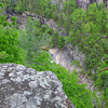 <h1>Zoomed in shot</h1>... of the portion of rock face a hiker has to scootch down along side Oceana Falls (which is just barely visible thru the trees) when you hike the Gorge Floor.   Shot from the South Rim along the Sliding Rock Trail.