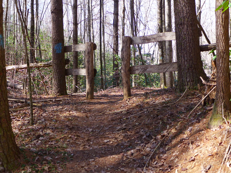 The trail continues through this gate.
