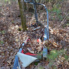 <h1>Weirdest thing ever found in the woods</h1>On my way back to the car, I decided to check out another trail that led up a hillside.   At the top, I found a clearing, with this <b><i>VERY</i></b> decrepit, decaying treadmill near a tree.     <i>Really??</i>            Yup ... really.
