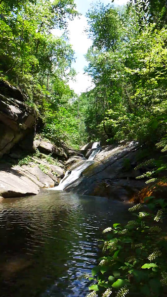 56 second video of my favorite waterfall along Emory Creek, located around elevation point 1500' I tried to give a feel for the massively tall, huge wall of boulders that line the western side of the swimming hole, but the video sort of minimizes them.<br /> <br /> To give a feel for perspective, the area in the dark shade under the lowest section of the overhanging boulders (time stamp 00:13) is tall enough that if you're standing in the pool at that point, you can stand straight up under those boulders.